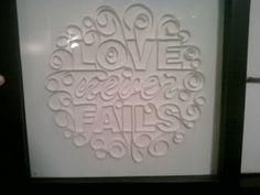 Quilled typographic art.