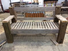 Rustic wood bench with barn tin back