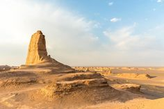 A rock formation rises from the desert floor in Dasht-e Lut, Iran. Photograph by Jakob Fischer, Alamy Stock Photo