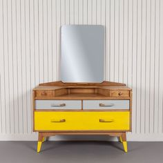 Eaton-£450.00-This timeless piece of 1950s design has been partnered with yellow and grey dip painted handles and feet to enhance its classic retro look.