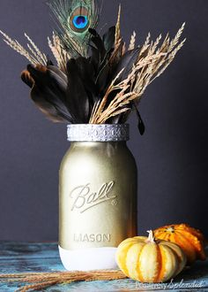 Craft a vase from a mason jar using paint and metal trim. A mason jar craft idea. Gold Mason Jars, Painted Mason Jars, Mason Jar Crafts, Mason Jar Lamp, Feather Centerpieces, Metal Pumpkins, Spring Projects, Diy Projects, Metal Vase