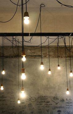 Reclaimed wood pendant lights at the Birdsong Cafe, Bandra, a suburb of West Mumbai, India I Remodelista