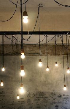 Reclaimed wood pendant lights at the Birdsong Cafe, Bandra, a suburb of West Mumbai, India I Remodelista