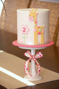Giraffe birthday cake by Couture Cupcakes & Cookies. So pretty and detailed yet simple...