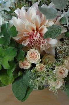 cafe au lait dahlia, blush roses and seasonal foliage including clematis, poplar, sage and geranium leaf | claredayflowers.ca