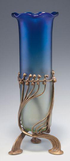 Loetz Wwe., Klostermühle. 'Luna' vase with bronze mounting by E. Bakalowits, 1901. H. 34 cm. Cased glass, slightly green/blue. Décor Luna optisch, slightly iridescent.   SOLD 2,800 EUR