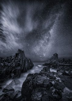 Please view with Black background :)  I took this shot at Bombo last year, 110 Km from Sydney.  The rock formation at Bombo are really dark, almost appear to be black during the night.   At the beginning we were trying to lighten the foreground up with headlight, but the result wasn't acceptable as the reflection was too bright.   After a while, cloud started to appear, which bounced the light to the foreground and produced a better result