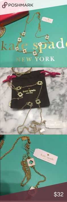"""NWT Kate Spade Reversible Hole Punch Necklace New with Tags and Approximately 30"""" in length, this listing is for the gold tone with white spades but please see my closet for the same necklace in black/gold. Matching or contrasting Soade earrings will be listed as well.  I will be happy to bundle the 2 pieces at a special price. The greatest thing about this authentic Kate Spade piece is that it can be be reversed and worn as ALL GOLD!  Retail price is $68. MAKES A GREAT GIFT AT THIS PRICE…"""