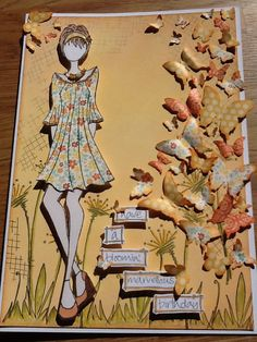 A card using paper artsy paint, Jofy stamps, Julie Nutting doll, and Tim Holtz butterfly die.