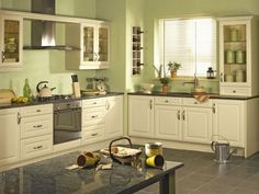sage green kitchen walls with white cabinets Green Kitchen Paint, Yellow Kitchen Cabinets, Green Kitchen Designs, Sage Green Kitchen, Kitchen Cabinet Colors, Kitchen Colors, New Kitchen, Kitchen Decor, Yellow Kitchens