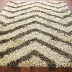 Shag rug for the famiy room, 9x12. Only because the rest of the family like fuzzy rugs  Chevron Stripe Shag Rug: 4 Colors