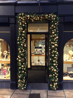 H R Tribbeck & Son is looking very festive. A dressed doorway is a distinctive way to have your shop or home decorated.