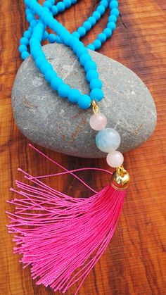 Long beaded blue and pink tassel necklace. by AllAboutEveCreations