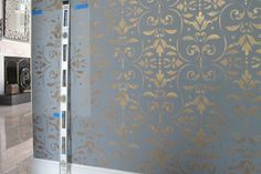 Wallovers Pompeian Ornament Stencil in process on these foyer walls.