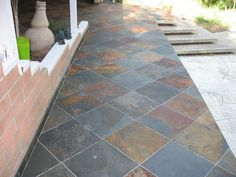 INSTALLATION OF SLATE TILE FOR BACKYARD PATIO PHOTO