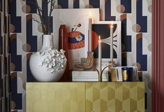 """The blues, metallics and terracotta of the Bauhaus-inspired geometric wallpaper are reflected by the other items"" says interior designer, Sophie Robinson."