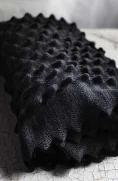 | P | Chunky charcoal grey knit blanket by Martensson. Photo Karin Bjorkvist www.braveproduction.com