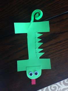 I is for iguana! It's kind of hard to think of animals that start with the letter I that a two-year-old would know what it is!!! During this project I just kept reminding her that this is an Iguana and showed her pictures of a real one!