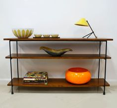 {simple vintage shelving unit} love the Cathrineholm on the shelf, too.