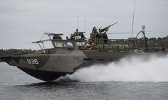 Swedish armed forces involved in the search off Stockholm. Photograph: IBL/Rex Features - Rex Features