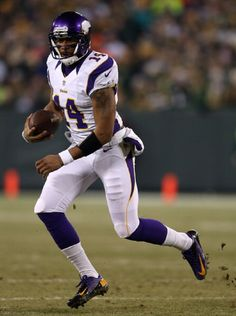 Quarterback Joe Webb #14 of the Minnesota Vikings runs the ball against the Green Bay Packers during the NFC Wild Card Playoff game on 5 Jan 2013