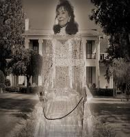 In 1967, Lorreta Lynn and her family bought an old plantation home near Hurricane  Mills. Shortly after moving in, they started experiencing strange phenomena like doors  opening and closing by themselves, seeing old women dressed in old fashioned clothes,  and civil war soldiers. Other strange phenomena they experienced was the sounds of  someone walking on their front porch and sometimes the sounds of someone walking  and dragging a chain on their porch. Later, after doing some…