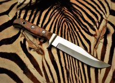 Handmade Hunting knife by South Africa knife maker Louis Naude.   The knife in this picture is called the Cougar and is available from Louis Naude (LEO) knives. Just waiting for your selection of handle material that includes wood and animal material like giraffe bone, Buffalo horn etc.  Louis Naude knives ships worldwide.