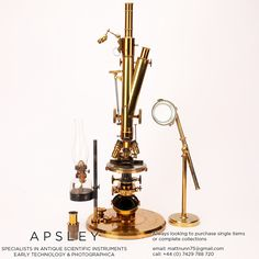 A ROSS-WENHAM UNIVERSAL INCLINING & ROTATING BINOCULAR MICROSCOPE, ENGLISH CIRCA 1888. Signed on the base Ross 5415 this is a fine example of Wenham's Universal Inclining & rotating microscope often referred to as the 'Ross Radial'. With microspectroscope