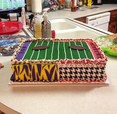Made this for an Alabama vs LSU party! White cake with some fondant decorations. Airbrushed!