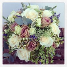 Vintage styled bridal bouquet of Amnesia roses, Vendella roses, wax flower, dille, white verconica and lavender.