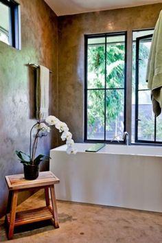 Beautiful bathroom. Love the stucco walls.
