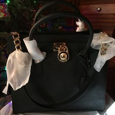 NEW Authentic Large Black Michael Kors Hamilton NEW ❤️Authentic Large black Michael Kors Hamilton Handbag. I purchased this beauty at Dillard's , but never got around to using it since I have a couple other ones I use. Still in original packaging , gold hardware and the dust bag is included !! The shoulder strap is not removable . This is a must have and the perfect Christmas gift!! Additional photos posted in a separate listing . Michael Kors Bags Shoulder Bags