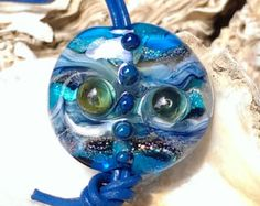 Lentil Pendant Mother Earth; Aqua, blue, sparkling metallic accents inside with waves transparent drops with air bubbles and dots - By W&Beads