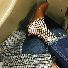 34731033c13 Fishnets are no longer considered rebellious or super sexy but are being  added to daytime outfits