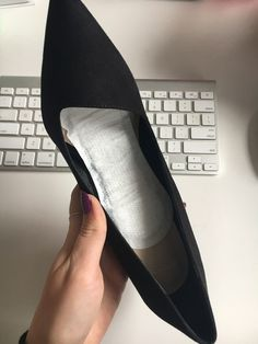 Line the inside of a shoe with a panty liner to absorb sweat and to keep your foot from slipping.