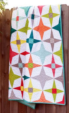 The beautiful big stars in her quilt design reminded designer Faith Jones of the twilight hours. Two different star patterns intermingle in her quilt, Twilight, for a spectacular result.
