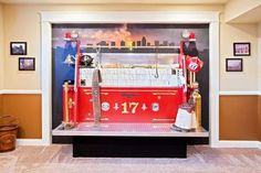 The back of a firetruck replica built into the wall for a bed.