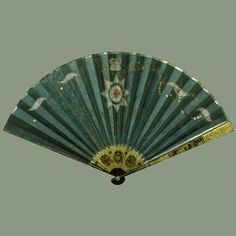The Garter Fan 1805 The Royal Collection This magnificent fan of blue plain weave silk leaf, is inscribed GR Royal, Windsor, and features japanned wood guards and sticks. Fan was probably purchased by Queen Mary,, it was known to have been in the inventory of Frogmore House, Windsor, prior to Mary's death in 1953, and has no documentation to support how it was returned to the Royal Collection.  The fan which features a painting of the Star of the Order of the Garter, has a Royal history.