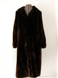 vintage 50s seal fur coat ... I remember my mom had a black seal fur coat in the 50s, it was like this one.  I hope they don't still make these.
