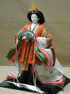 An uncommon standing hina (girls day holiday) doll.