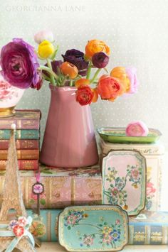 vintage tins..I wonder if could do this w/ old canape trays,spray paint and vintage wallpaper..hmmmm..must try