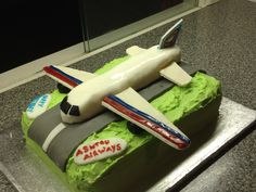 Aeroplane cake for a 4 year old's birthday. Chocolate cake covered in butter icing with an aeroplane made out of ready-made white fondant icing. Wings and tail are pastillage (a bought mix I just added water to).
