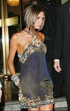 Victoria Beckham in a black jeweled dress..wow a bit short for me but love the style.