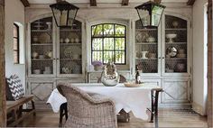 imageJill Brinson's dining room; love the chicken wire-arched doors.
