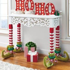 Give your entertaining decor a real leg up this holiday season with Katherine's Collection Elf Table Leg Covers. Constructed of a sturdy, stretchy, high-quality velvet, these stockings can accommodate all styles of table legs. Delightful embellishments, from the candy-apple-red striped stockings to the jaunty curl at the end of each toe, transform an ordinary table leg into a delightful set of gams. These stockings transform an ordinary table into a conversation piece for holidays to come…