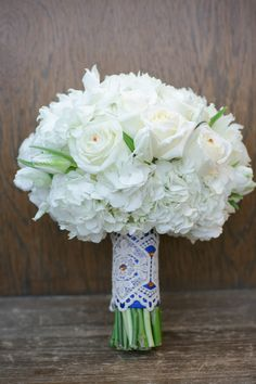 White bouquet with a Spanish inspired stem wrap- love! // photo by BrittRene Photo, see more: http://theeverylastdetail.com/cobalt-blue-spanish-inspired-wedding/