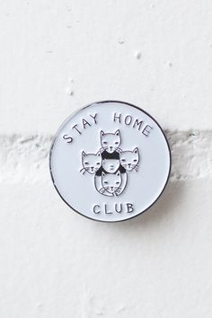 """Soft enamel lapel pin in mirrored black and white featuring our ubiquitous cat logo. 1"""" wide. Comes on card backing."""