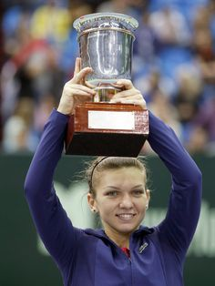 Romania's Simona Halep displays the trophy after defeating Australia's Samantha Stosur during the final match at the Kremlin Cup. (AP)