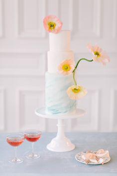 wedding cake with flowers - photo by Julie Wilhite http://ruffledblog.com/spring-french-garden-wedding-inspiration