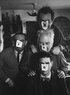 Artist Rene Bouche, violinist Alexander Schneider, sculptors Alexander Calder & Constantino Nivola,wearing paper masks at party at Calder's Roxbury home. 1959.